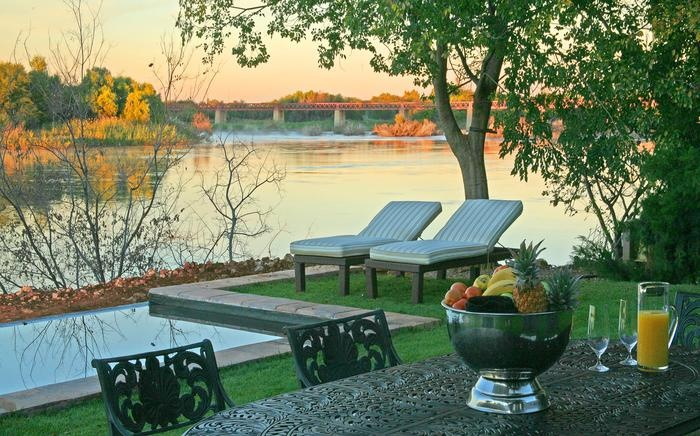 River Place Guest House, Upington. A beautiful view, river and swimming pool. Perfect for lazy, summer days.