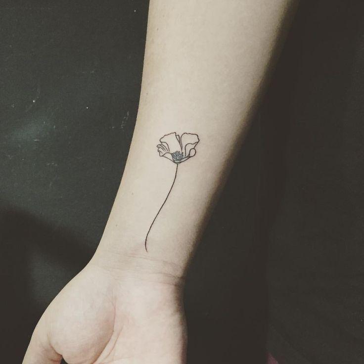 Black and white poppy tattoo