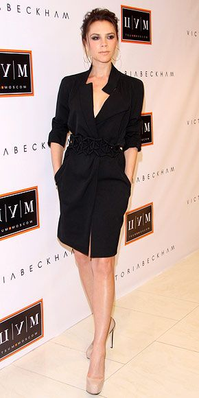 Beckham accented her Victoria Beckham shirtdress with an origami-inspired belt and patent platforms. V
