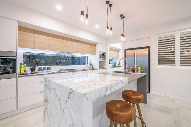 Marble-look laminate kitchen island bench. Leather bar stools. Window splash-back. Timber-look overhead cupboards.