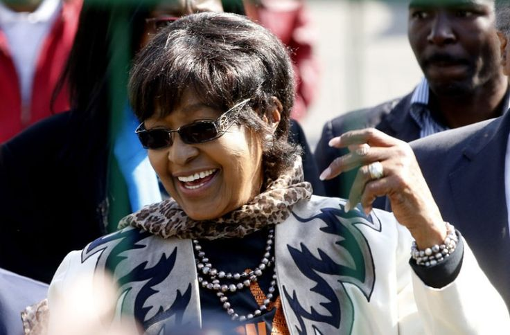 Winnie Madikizela-Mandela greets people who have  gathered to wish to former President Nelson Mandela happy birthday outside the hospital where he is being treated