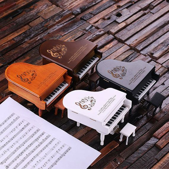 Music and Jewelry Box For the Piano Darling! This miniature dark wood baby piano gift is both outstanding and beautiful in its simplicity. It comes with a miniature chair and details of an authentic baby grand. Look at the charming gold -tone foot pedals! We engraved to show what a