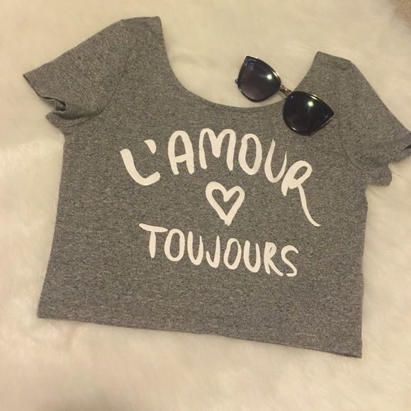 "24HR SALE H&M Divided Crop Top H&M Divided Crop Top in Gray with ""L'AMOUR TOUJOURS"" across the front. Very good condition, only worn a couple times! H&M Tops Crop Tops"