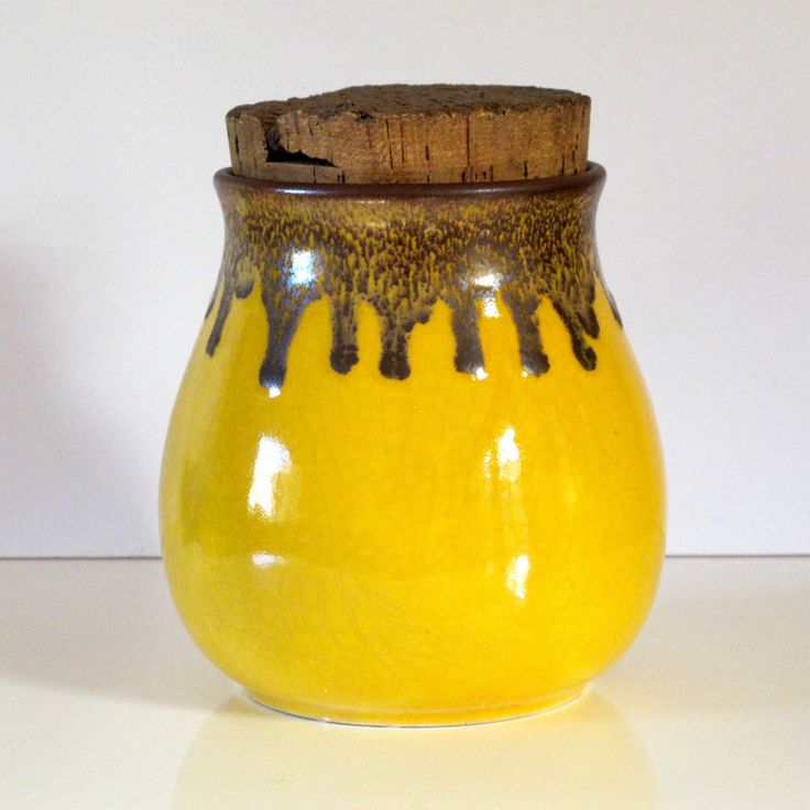 Approx 160mm high. Rich mustard yellow crackle glaze under a brown drip glaze and fully glazed interior. Possibly Hanstan, though the incise base mark is unclear and its an unusual colour set.