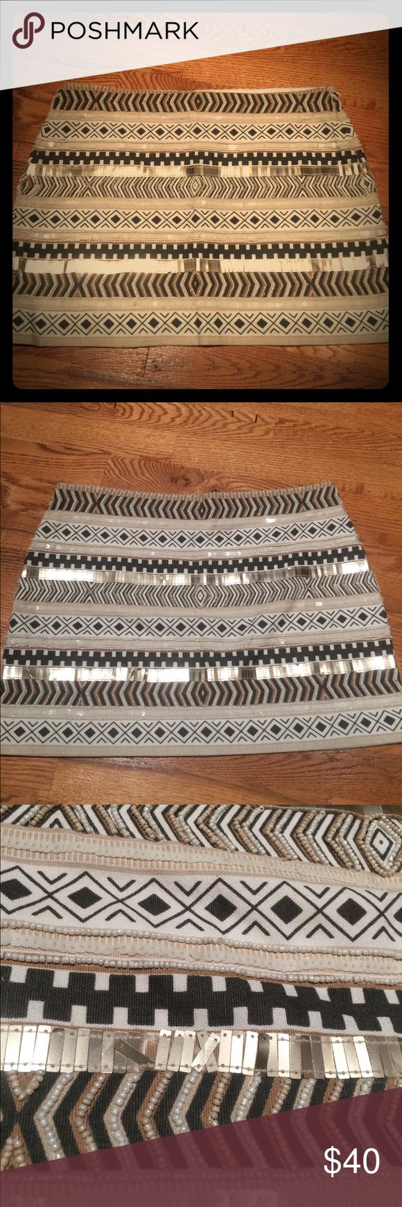 "Zara Aztec beaded mini skirt size large brown/tan Zara beaded Aztec mini skirt. Size large. Few loose or missing beads a pictures show, but not noticeable with skirt on! Measurements are about 15.5"" waist laying flat and littler over 13"" long. Beading is on both sides. Stunning skirt!! Zara Skirts Mini"