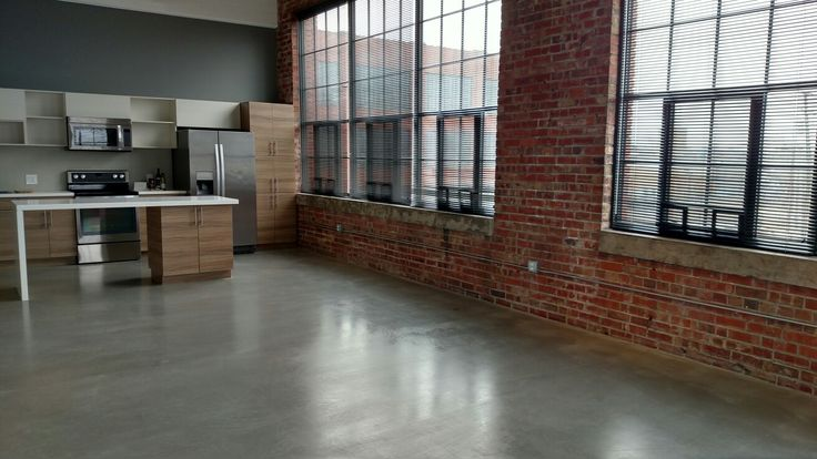 Exposed brick walls and polished cement flooring 💜⭐