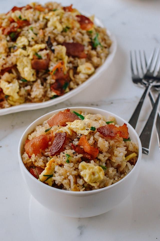 """So you have some leftover rice from your week of awesome """"serve with rice"""" dishes. Know what that means? It's time for fried rice — the perfect vehicle to use up any and all leftover rice in your fridge. In fact, it's time for one of our simplest, most flavorful fried rice dishes: bacon and egg fried rice."""