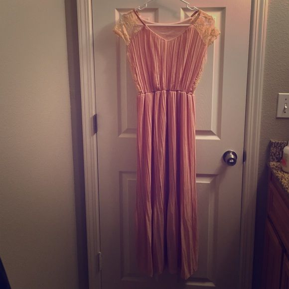 Nude long dress NWOT This dress is beautiful! It's more of a nude color than it shows in the pictures. The lace is gorgeous! The dress has a built in slip that goes to the knees so it's a bit see through from the knees down. Doesn't have a size tag on it but it fits small/medium. Dresses