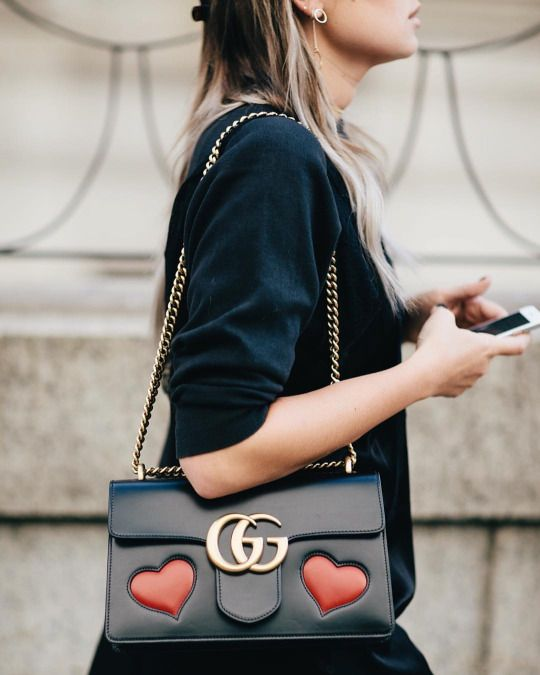 Danielle Bernstein wearing the Gucci GG Marmont Heart bag at New York Fashion Week before Jonathan Simkhai. September 2016. by Shelby Rodriguez