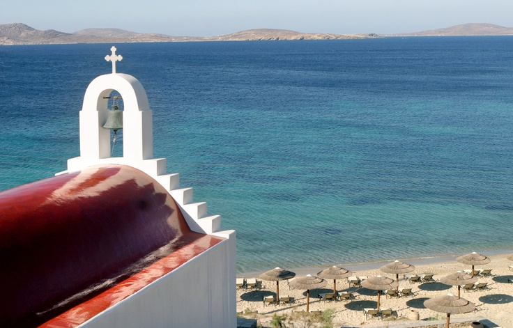 Hotel Chapel with striking red rood, dedicated in Virgin Mary, close to the resort Beach at Mykonos Grand Luxury Hotel