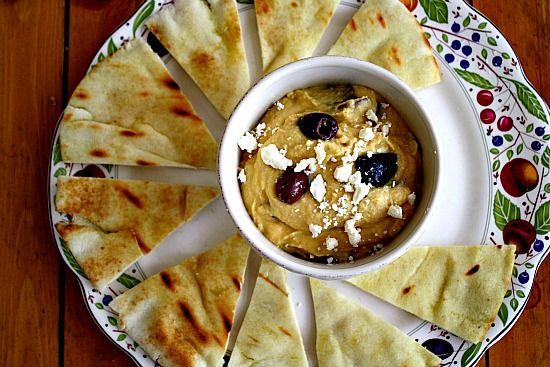 Ya Ya's Restaurant Famous Hummus. Feta, olives and chili oil make for a great combo for hummus.