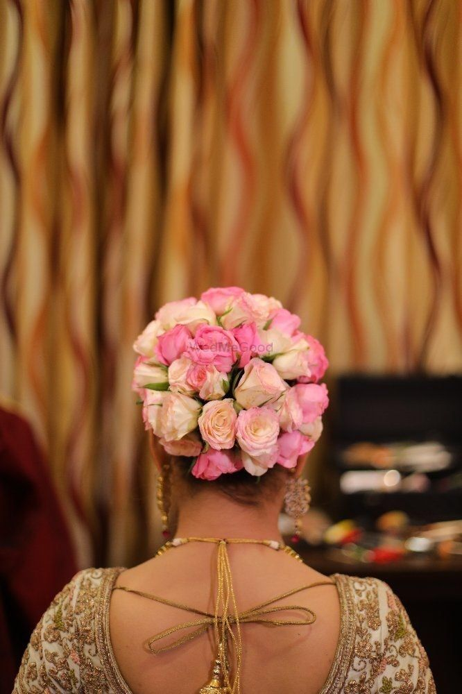 Bridal Bun With Pink And White Roses For Wedding Wedmegood