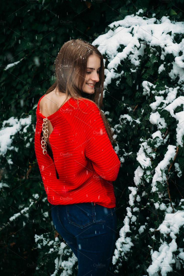 Beautiful young girl model in winter in a parked park. in a red sweater. by Oleksandr Masnyi on @creativemarket