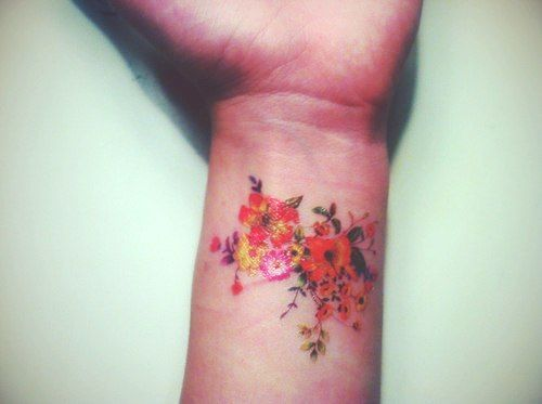 style of flowers for tattoo, feminine/detailed/no outlines, would like the flowers a bit larger