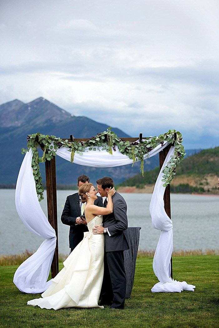 Adore this rustic arch at this Colorado destination wedding in Dillion | Design by Elizabeth Events | Photography by Dawn Sparks