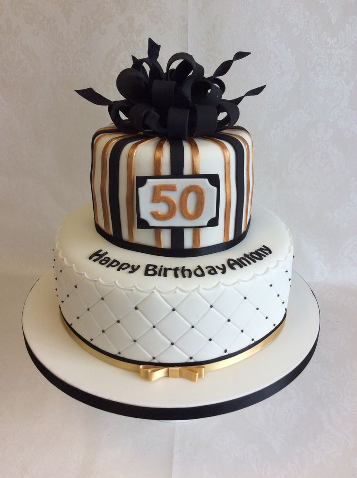 Parcel style top tier for this 2 tier black and gold themed birthday cake