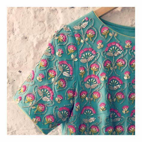 Daisy Maxi closeup . Beautiful powder blue color daisy maxi with floret lata design classy hand embroidery work from Summer by Priyanka Gupta. 13 December 2017