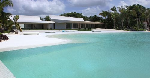 This home's pool was built to resemble a white sand beach