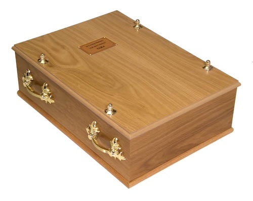 A Deluxe Oak Pet Casket, an elegant way to bury a beloved pet.