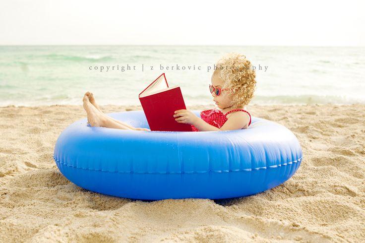child reading on beach