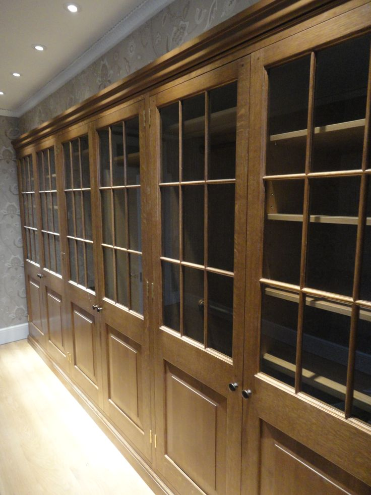 A range of panelled/glazed cupboards