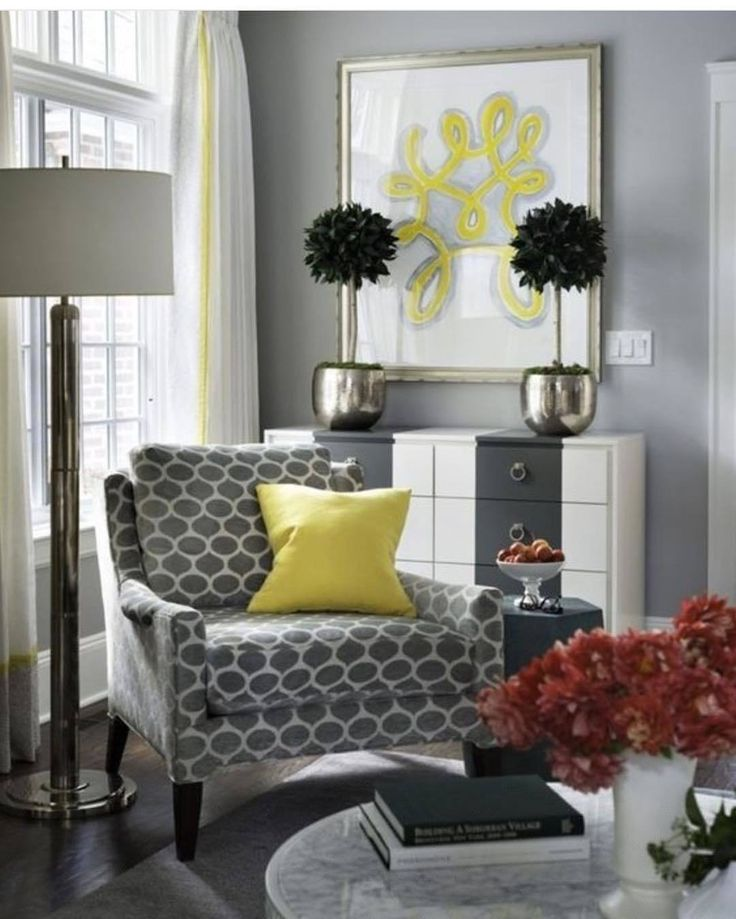 Yellow And Gray Living Room Features A Corner Reading Chair Adorned With