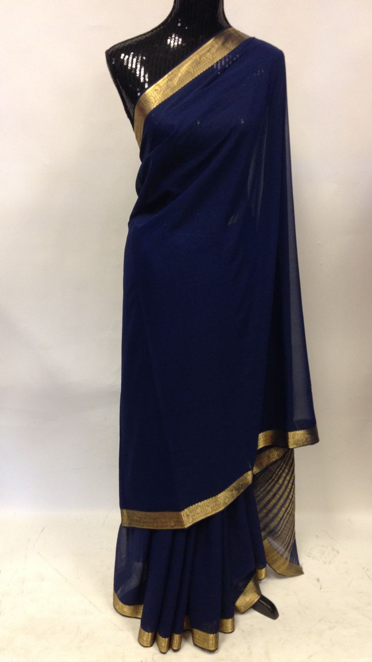 Chiffon lightweight plain blue Saree with golden zari border high in demand due to its crepe like texturee.Popular among Indian ladies due to its ultra luxurious and highly fashionable look and feel.g