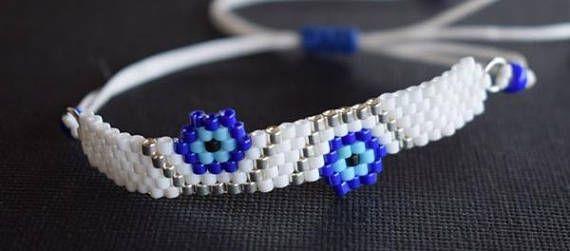 Handmade item.Beaded bracelet.Evil eye  flower