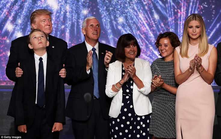 Solidarity: At the end of the night, Trump's family and Mike Pence's family joined the stage. Pictured above right to left: Ivanka Trump, Charlotte Pence, Karen Pence, Mike Pence, Donald Trump and Barron Trump (front left)