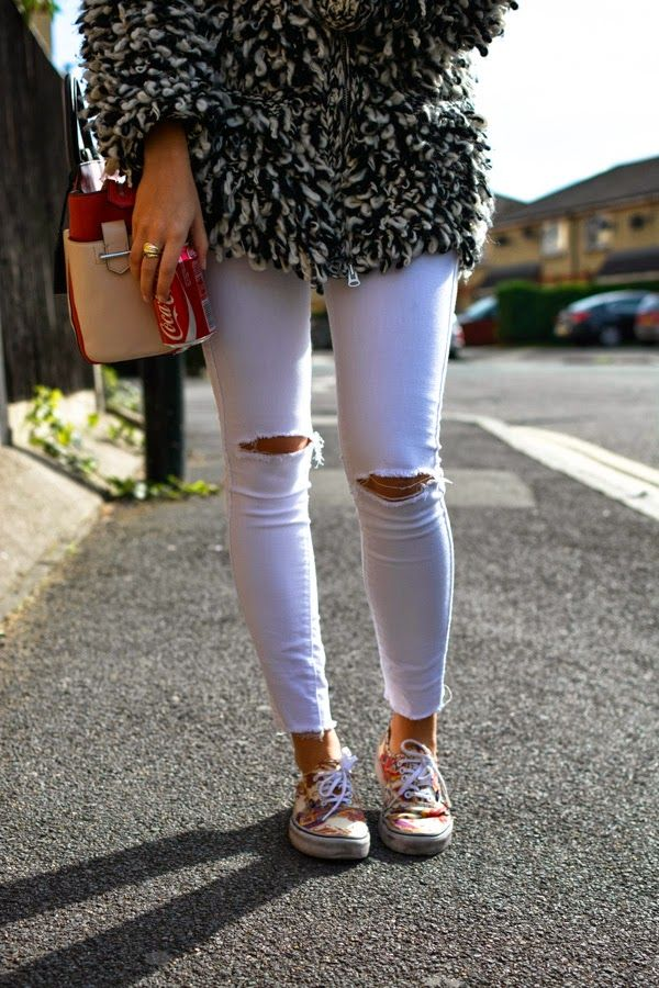 Distressed White Jeans, Isabel Marant Coat and Reed Krakoff Bag.