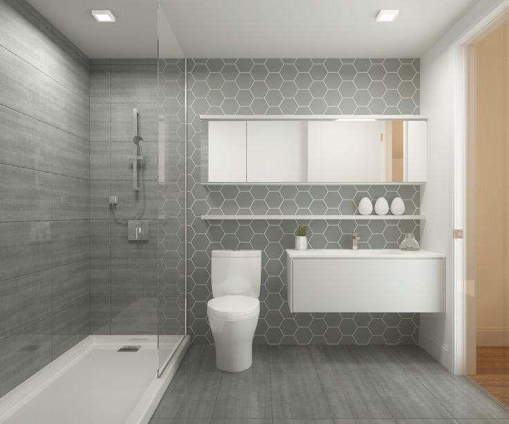 Salle de bain avec grosse céramique grisew avec douche vitrée et meuble robinet suspendu