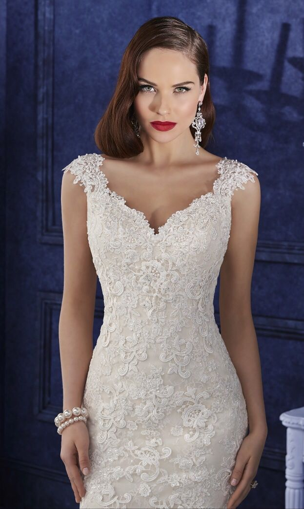 Fishtail lace fitted gown with gorgeous embellishment and a low back available at With Love Bridal Boutique