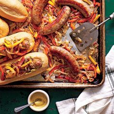 Sheet Pan Suppers from 'Southern Living' ~ Bratwurst with Peppers and Onions Recipe ~ If you're lucky enough to have leftovers, wrap hoagies in foil, and reheat in a 350° oven for 15 minutes.