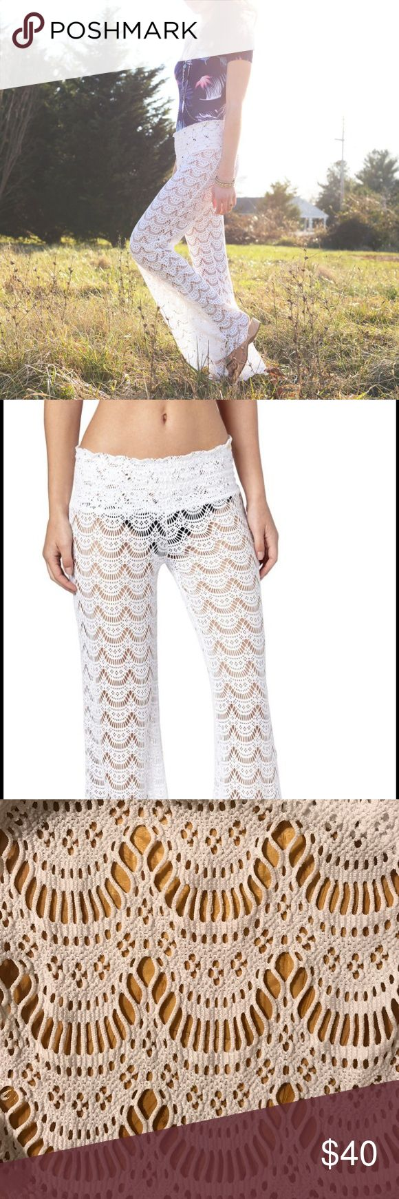 Roxy Gypsy Moon Crochet beach pants in white Roxy Gypsy Moon Crochet beach pants in white. Elastic waist band. Completely see through to be worn as a beach cover up. Beautiful fabric is stretchy and flared at bottom. Perfect for a Bachelorette party, summertime fun or festival outfit. Roxy Swim Coverups