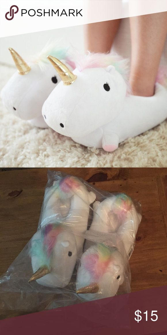 **BRAND NEW** light up unicorn slippers! Brand new in the bag unicorn light up slippers, with batteries. Fit small/medium (size 6-9) smoko Shoes Slippers