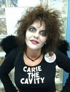 Why do you think Carie the Cavity loves tooth decay?