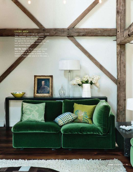 modern gustavian... exposed beams and green velvet sofa