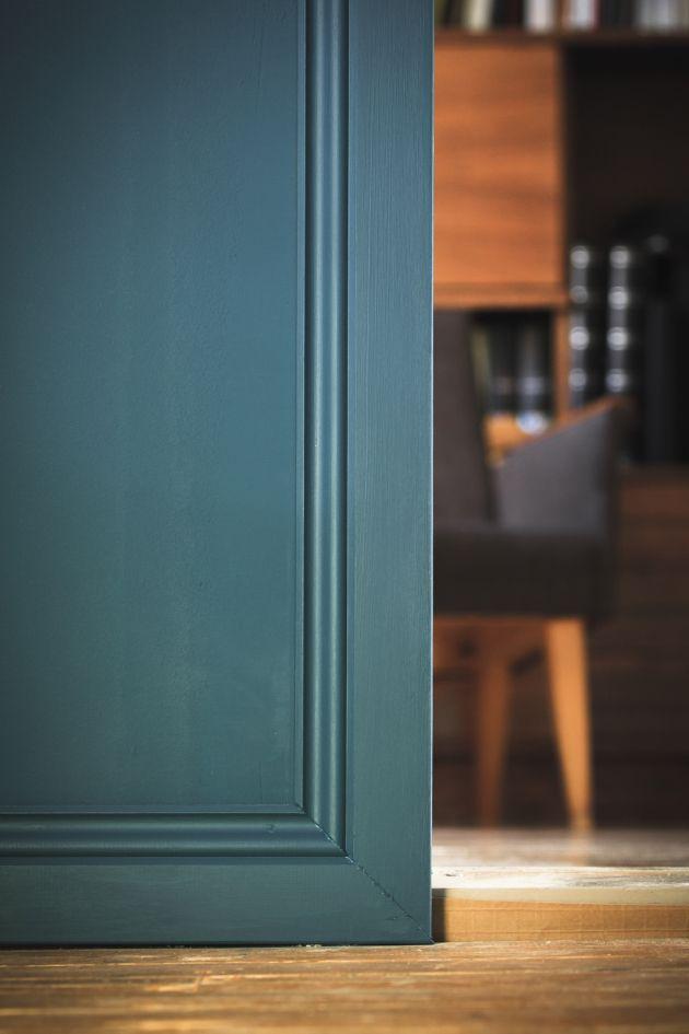 Door mouldings, old wood floor, dark turquoise