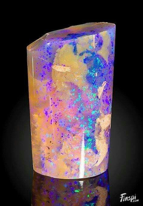 Unique Opal after a fossilized Belemnitel Locality: Andamooka opal fields, Andamooka Ranges, Stuart Shelf, South Australia, Australia. Geology Wonders