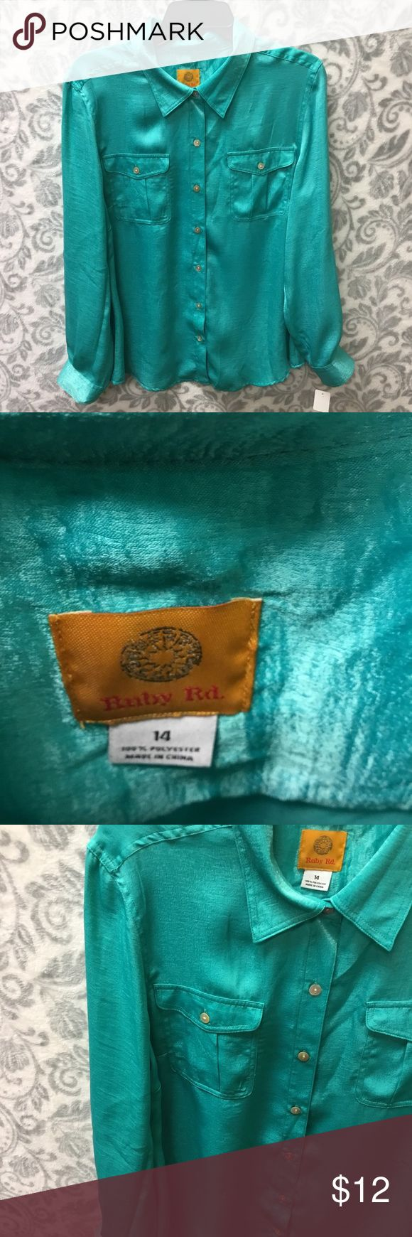Seafoam green/turquoise ruby rd. button down Size 14 blouse in excellent condition  It's so hard to capture blues and greens on camera. The color is most like a shiny version of the fifth picture  Buttons all attached and sturdy  Size 14 (large/xlarge)  If you have any questions, please feel free to ask!  Bundle and save! Ruby Rd. Tops Button Down Shirts
