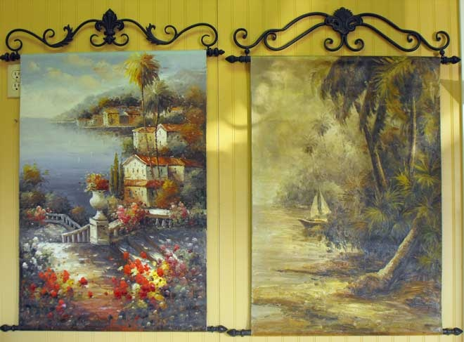 Oil on canvas hanging from wrought iron scrolls ~ beautiful!