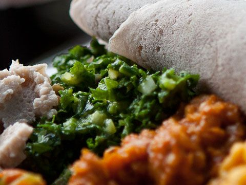 Kedija Selata merges minced kale with avocado, tomato, jalapeno, and lime