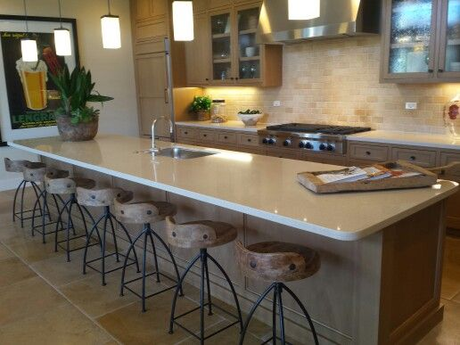 Kitchen area at Tastings room. Large long table is to the left of the stools