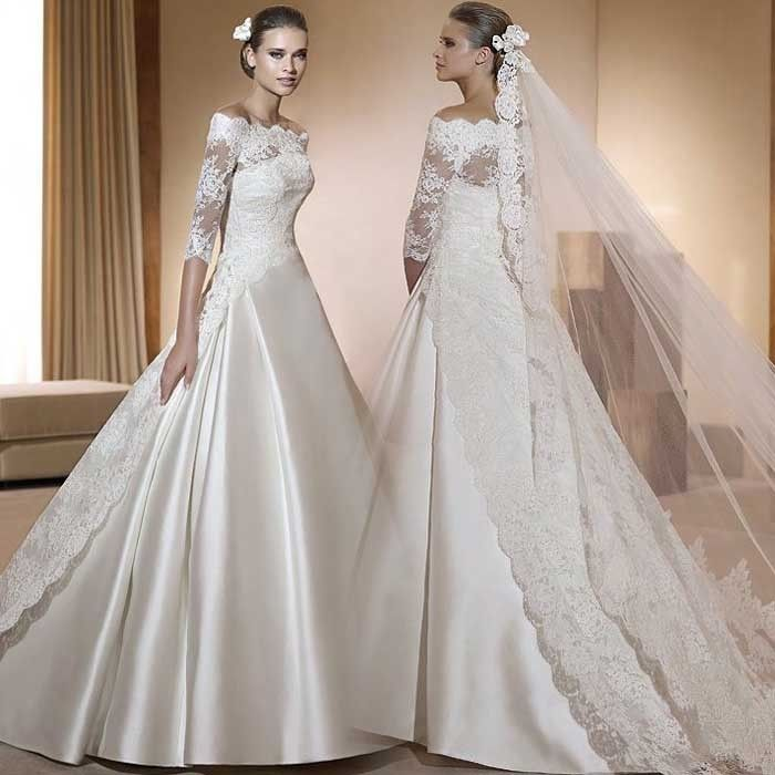 wedding dress with lace neckline and quarter length sleeve, falling to train in the back, ball gown style