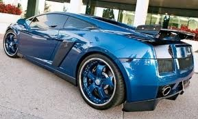 """chris brown's lambo he bought himself on his 18th birthday spiderman interior and 22"""" rims in the back and 18"""" in the front customized to him."""