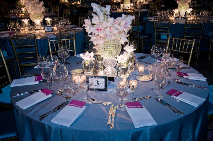 In October the Field Museum's annual gala in Chicago had a diamond theme, complete with tiered crystalline centerpieces atop illuminated mirror boxes, surrounded by mini vases of blush cymbidium orchids.