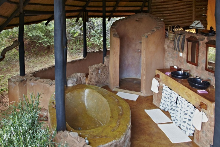 Rustic African Lodge Bathroom, concrete bath, screed floor, outside inside effect
