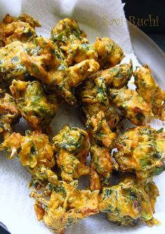 Spinach and Cabbage Fritters Shredded Spinach: 2 cups Shredded Cabbage: 1 cup Carom seeds/Ajwain/Om kalu: 1 tsp Red chili powder: 1 tsp Salt: As needed Turmeric powder: 1/2 tsp Gram flour/Besan: 1 cup Rice flour: 2 tbsp Fine Rava/Chiroti rava/Cream of wheat: 2 tbsp Hot oil: 1 tbsp Water: Approximately 1 to 1.25 cups