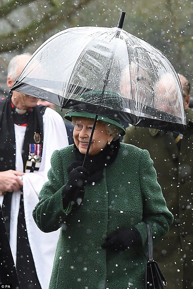 Singing in the reign! Her Majesty didn't let the rain dampen her spirits as she left the c...