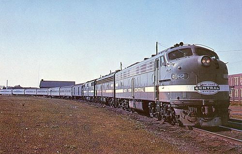 "Postcard - NYC's ""New England States"" train at Englewood Station outside of Chicago, IL. EMD E8 diesel locomotives leading the way from Bost..."